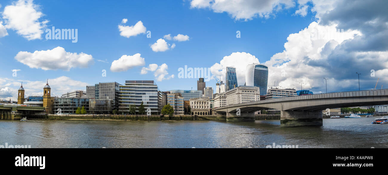 Panoramic view of City of London skyline: River Thames at London Bridge, the Walkie Talkie, Cheesegrater, Adelaide House and Cannon Street Station - Stock Image
