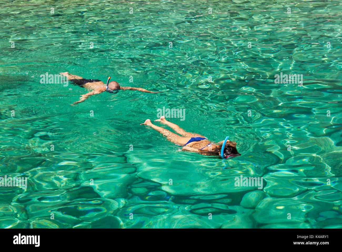 Persons snorkeling near keri blue caves bay  in Zakynthos (Zante) island, in Greece Stock Photo