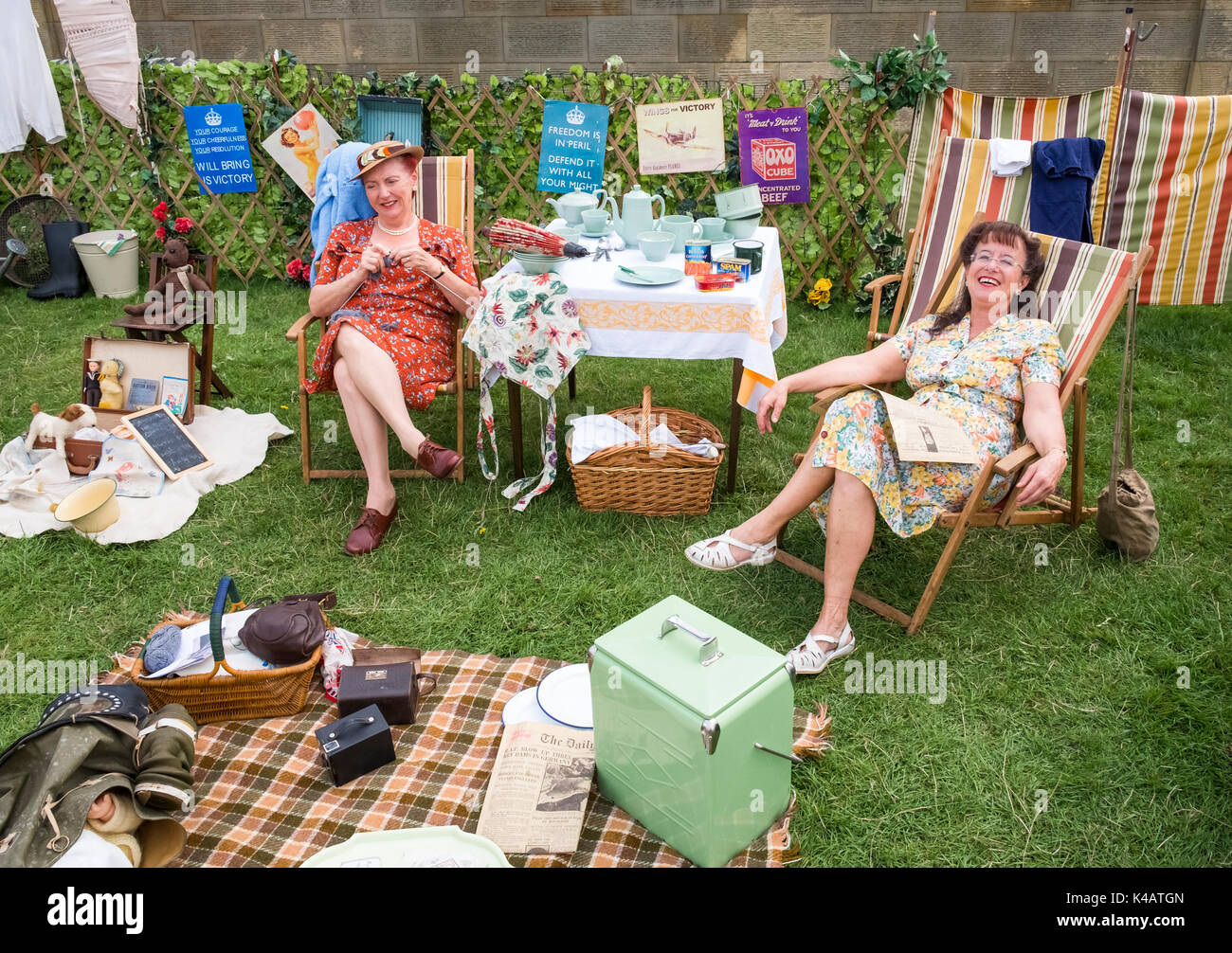 Two women re-enactors at a 1940s Living History camp, Derbyshire, UK - Stock Image