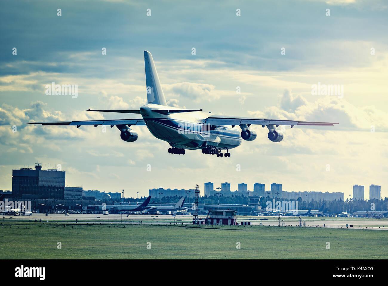 Landing of big cargo airliner. - Stock Image