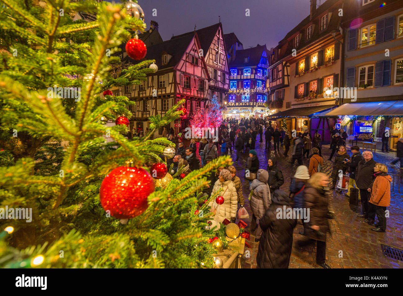 Colorful lights on Christmas trees and ornaments at dusk Colmar Haut-Rhin department Alsace France Europe Stock Photo