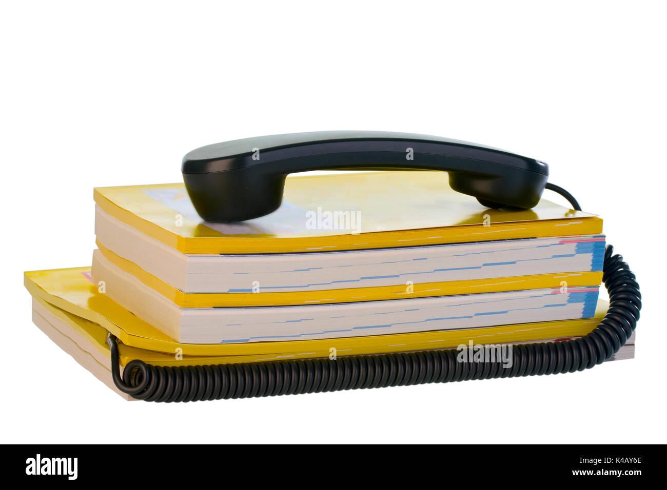 Telephone Handset On Phone Books - Stock Image