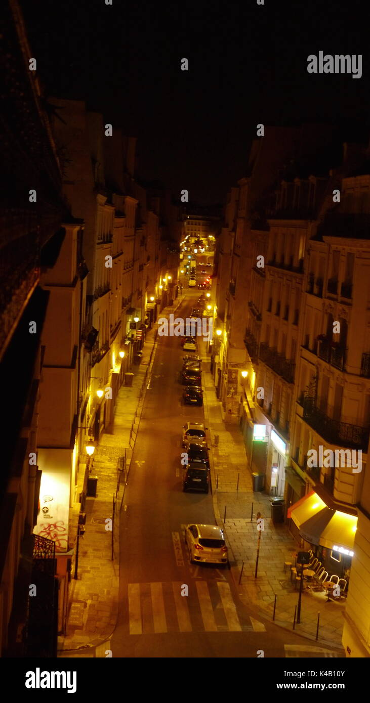 rue de Temple in Paris taken from a top floor balcony. The image was taken in August when there is no traffic and few people. - Stock Image