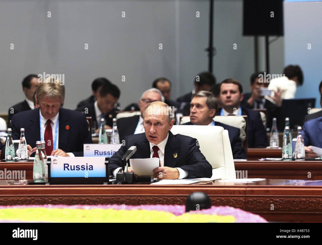 Xiamen, China's Fujian Province. 5th Sep, 2017. Russian President Vladimir Putin speaks at the Dialogue of Emerging Stock Photo