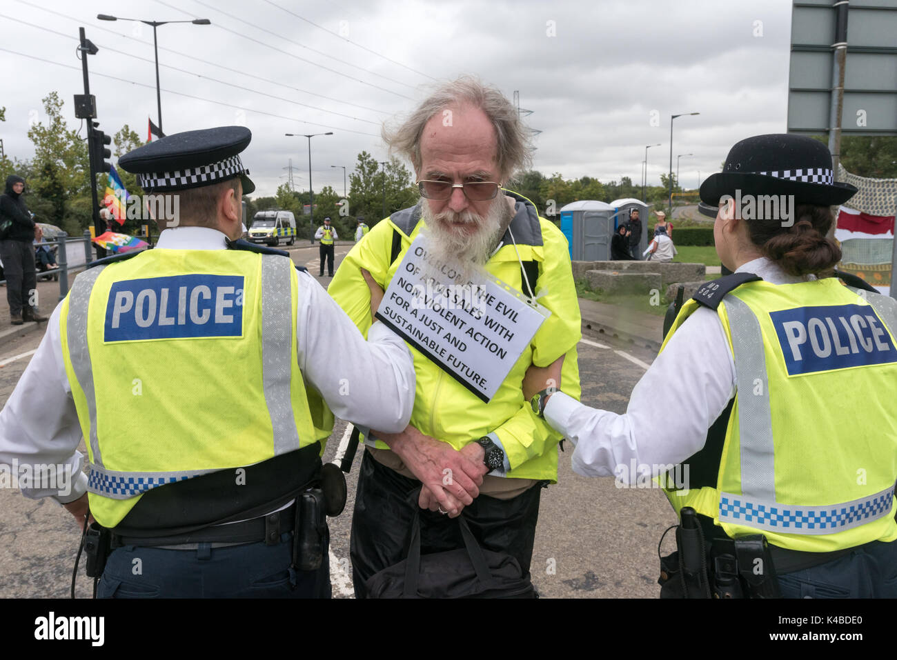 London, UK. 5th Sep, 2017. Police lead a Quaker protester backwards towards a police van under arrest for obstructing Stock Photo