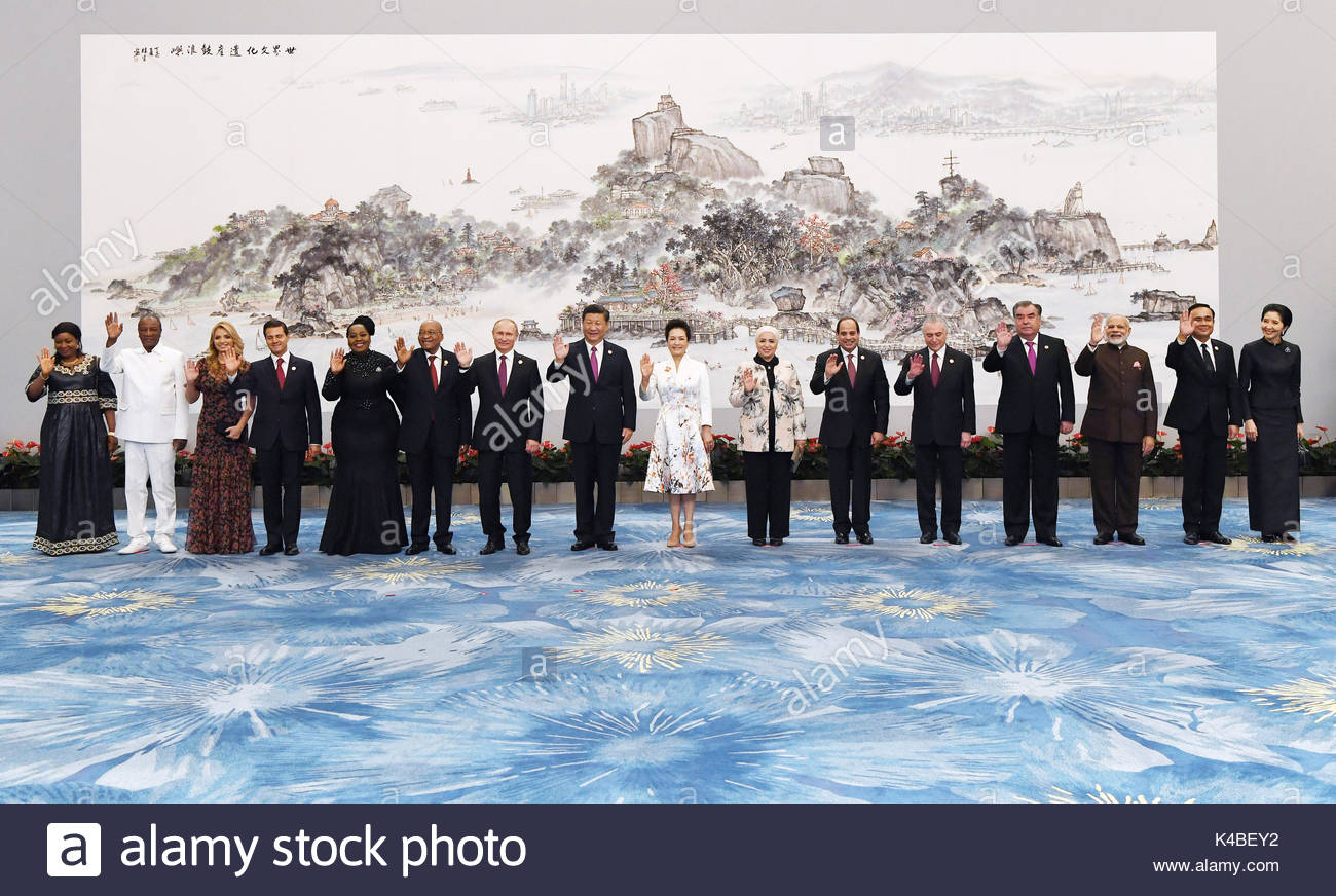 Chinese President Xi Jinping and his wife Peng Liyuan pose for a group photo with leaders attending the 9th BRICS Stock Photo