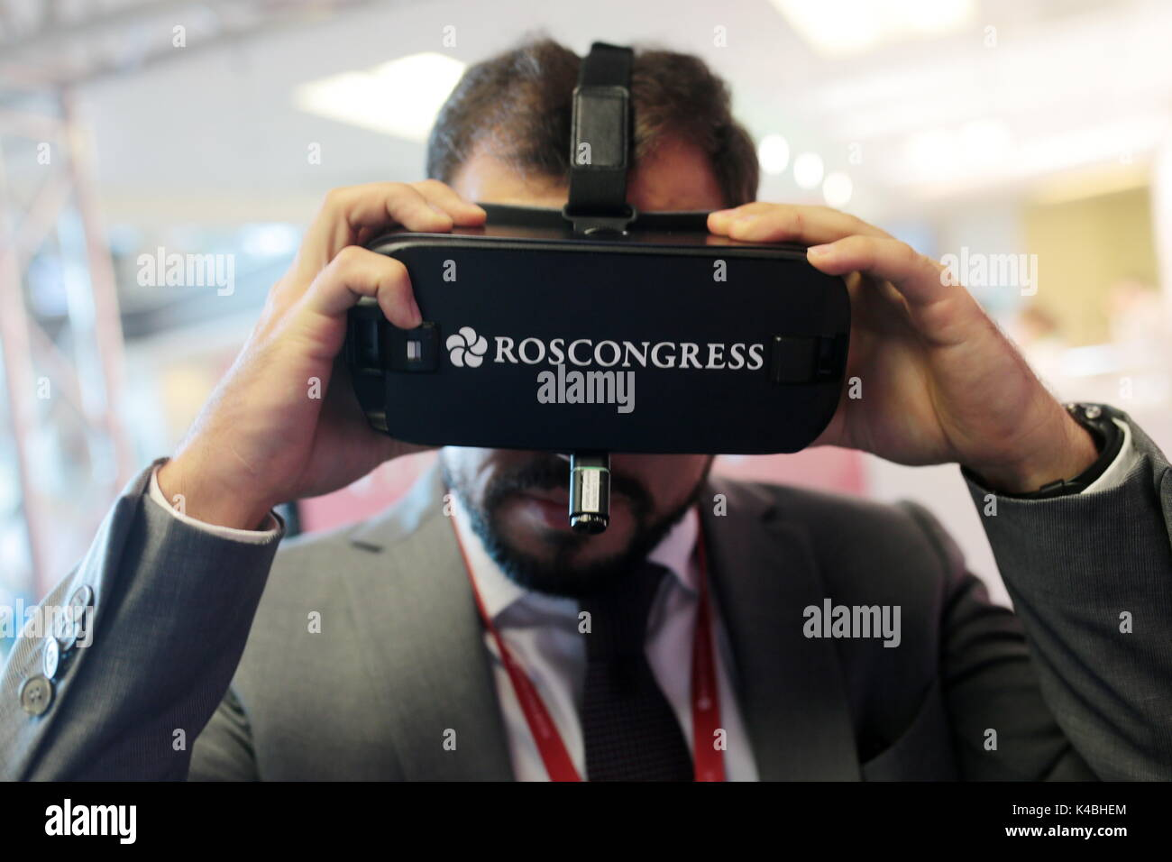 Vladivostok, Russia. 6th Sep, 2017. A mna in a VR headset seen at Sberbank stand at the 2017 Eastern Economic Forum (EEF) at Far Eastern Federal University on Russky Island. Credit: Sergei Bobylev/TASS/Alamy Live News - Stock Image