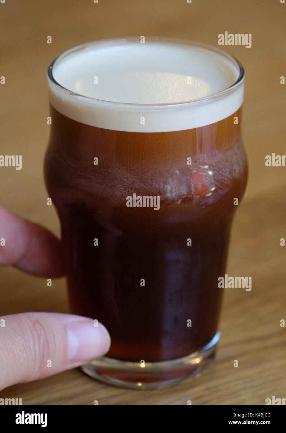 Berlin, Germany. 29th Aug, 2017. A glass of so-called nitro coffee on a table in Berlin, Germany, 29 August 2017. The drink is made by pouring cold-brewed coffee to which nitrogen has been added from a tap. The result is a coffee that is silkier and creamier. Photo: Jens Kalaene/dpa-Zentralbild/ZB/dpa/Alamy Live News - Stock Image