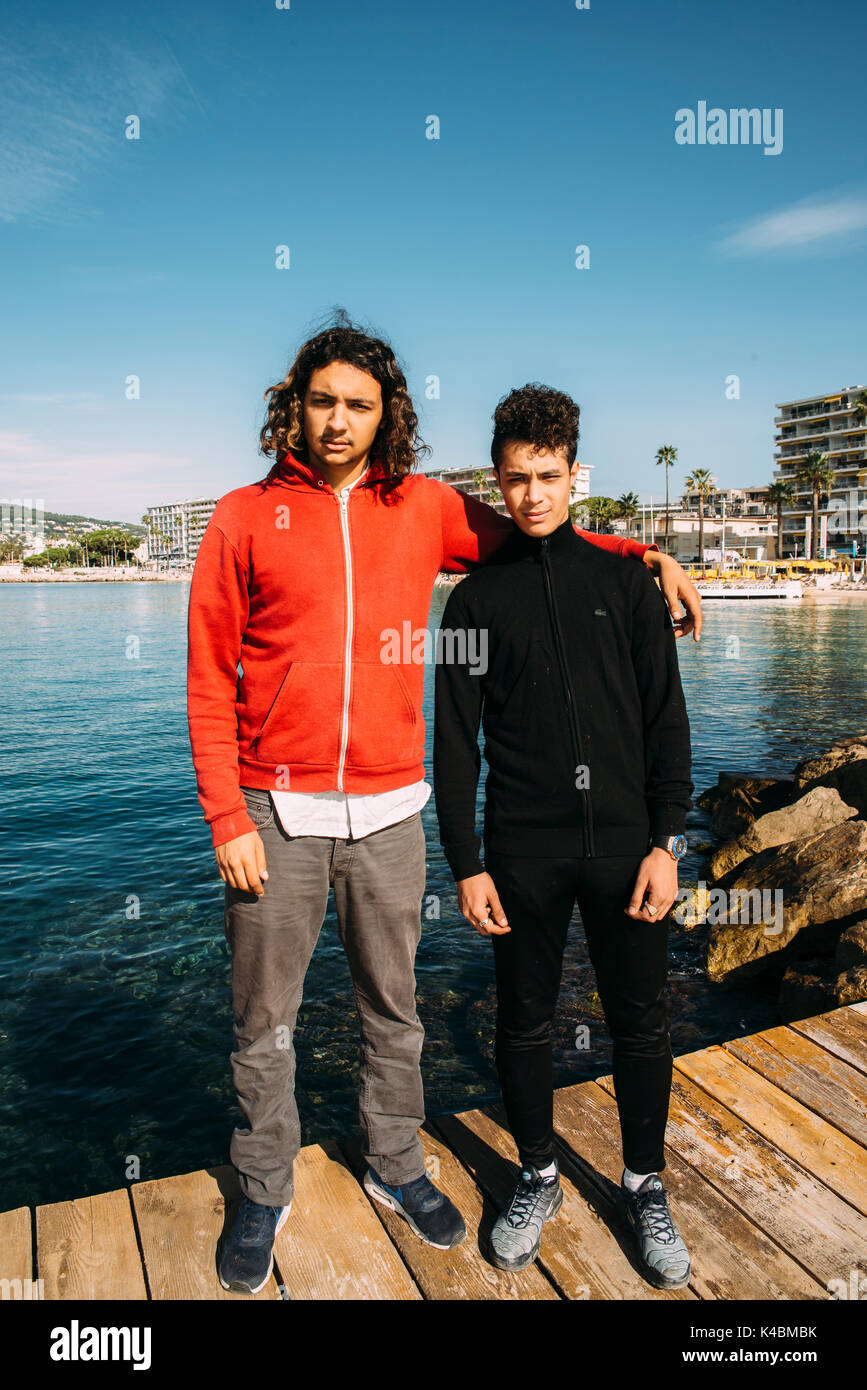 Two young French men of Algerian descent pose for a picture in Juan les Pins, Cote d'Azur, France. France has large MAGHRE population - Stock Image