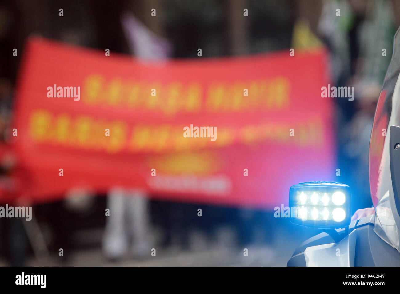 Police Signal With Protesting Activists - Stock Image
