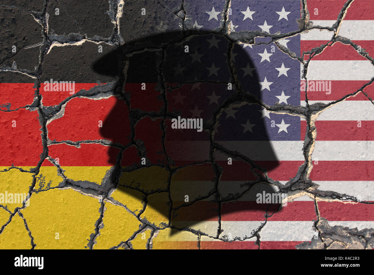 Silhouette Of Donald Trump With Flags Of Usa And Germany On Eroding Ground Stock Photo