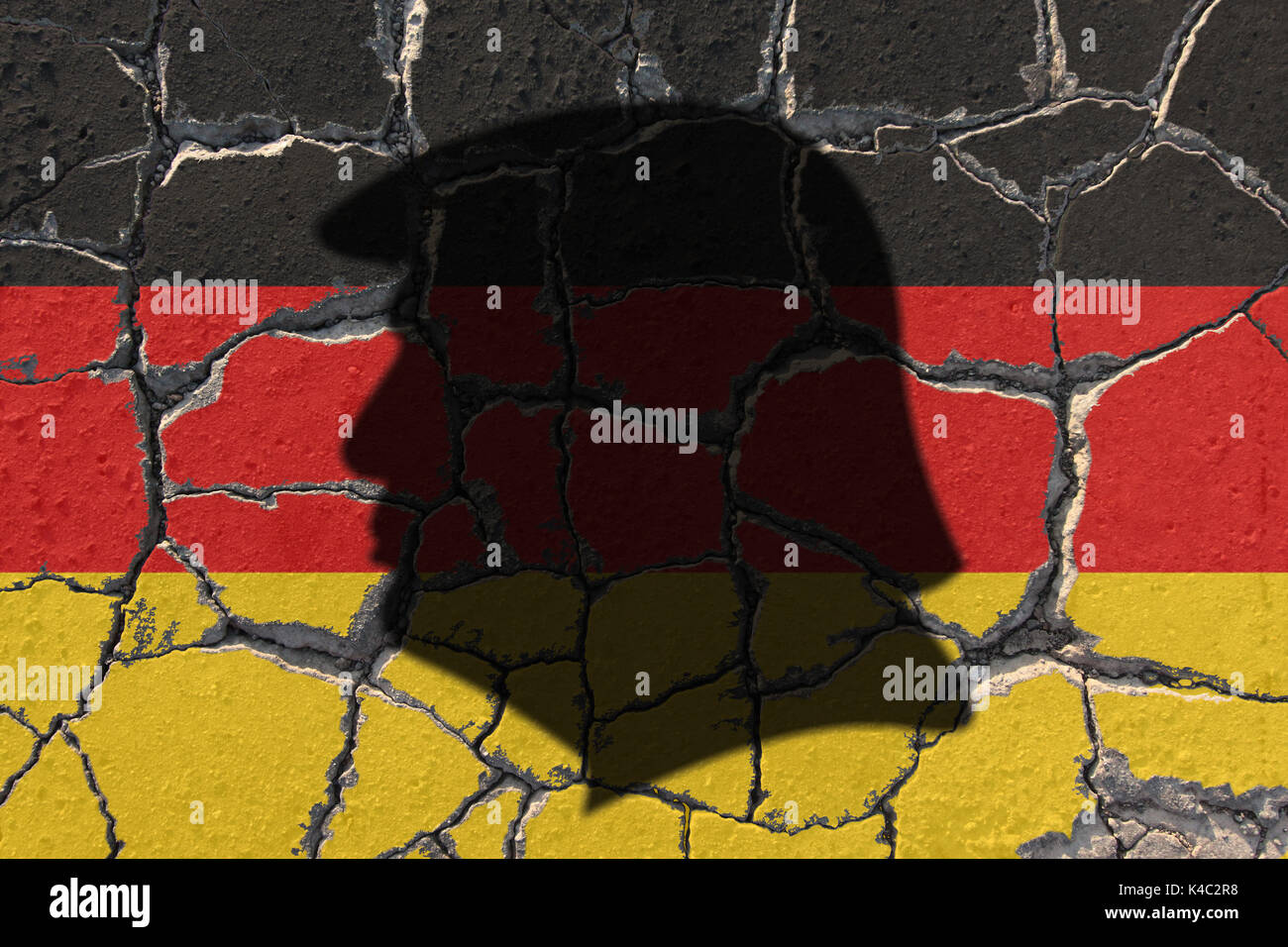 Silhouette Of Donald Trump With Flag Of Germany On Eroding Ground Stock Photo