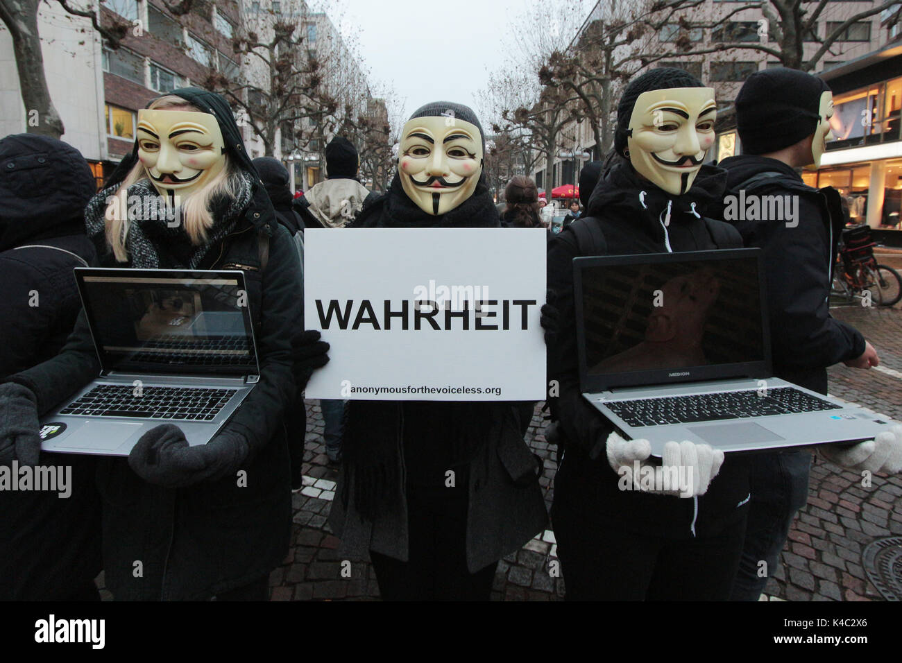 Anonymous Activists Wearing Guy Fawkes Masks Holding A Sign Truth - Stock Image