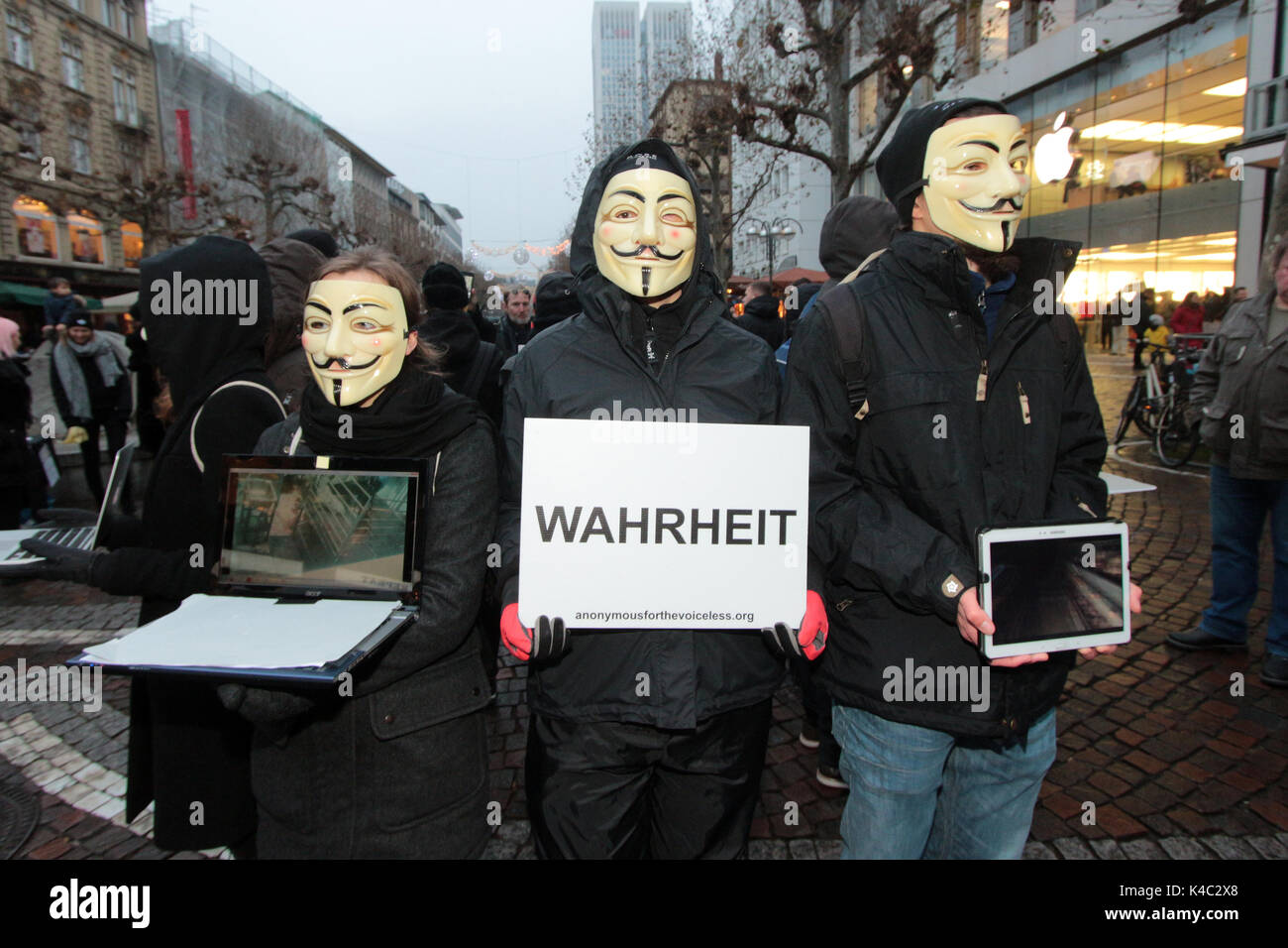Anonymous Activists Wearing Guy Fawkes Masks Holding A Sign Truth Stock Photo