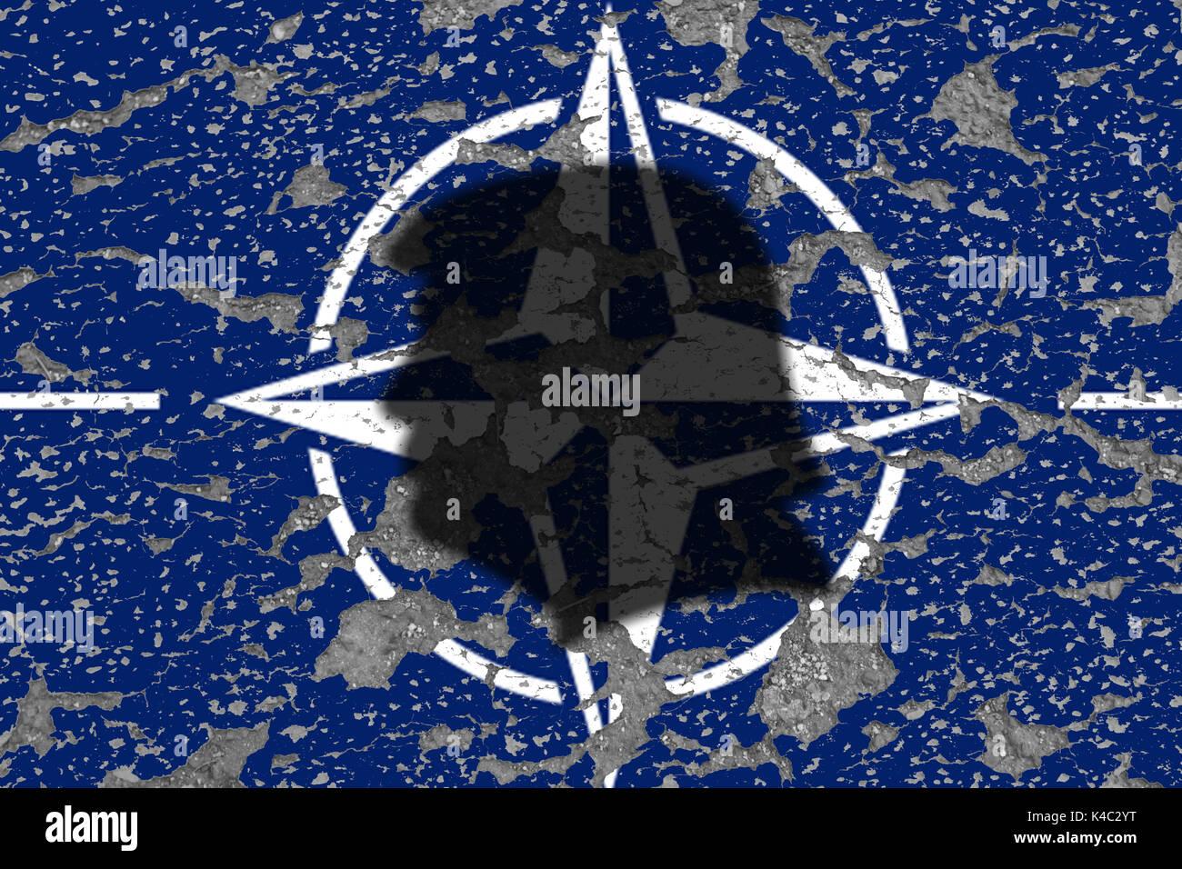 Donald Trump Shadow With Eroding Nato Otan Sign Stock Photo