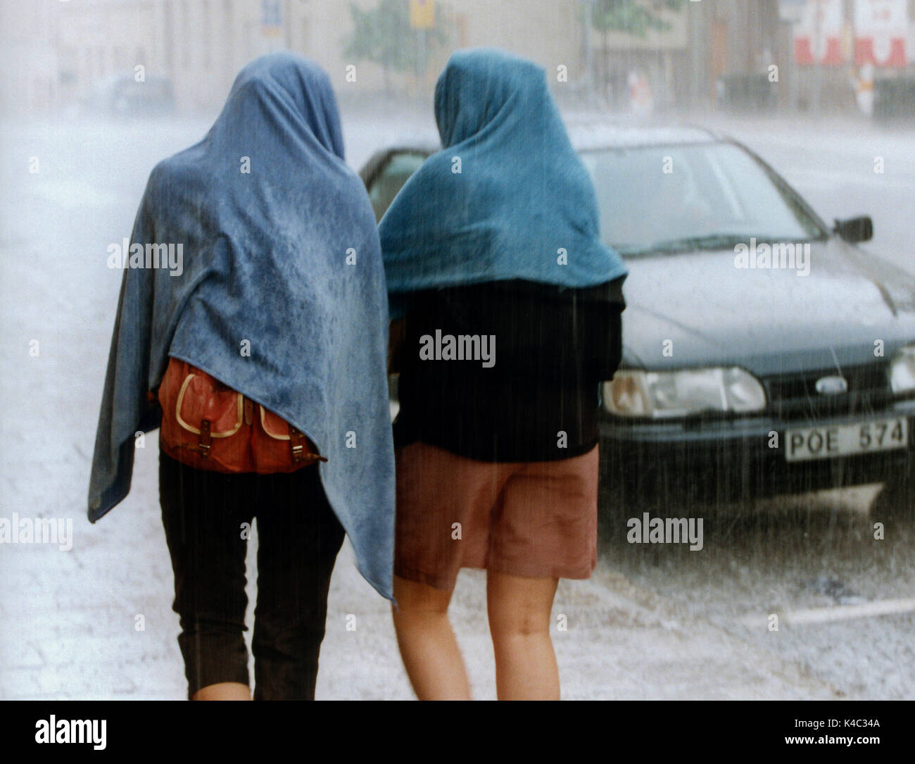 TWO WOMEN walk when the rain drops down 2016 - Stock Image