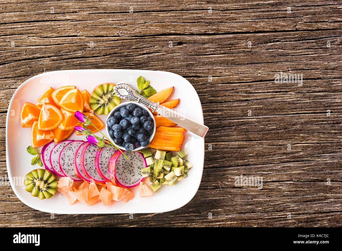 Pitaya, orange, kiwi, carrot, blueberry - Stock Image