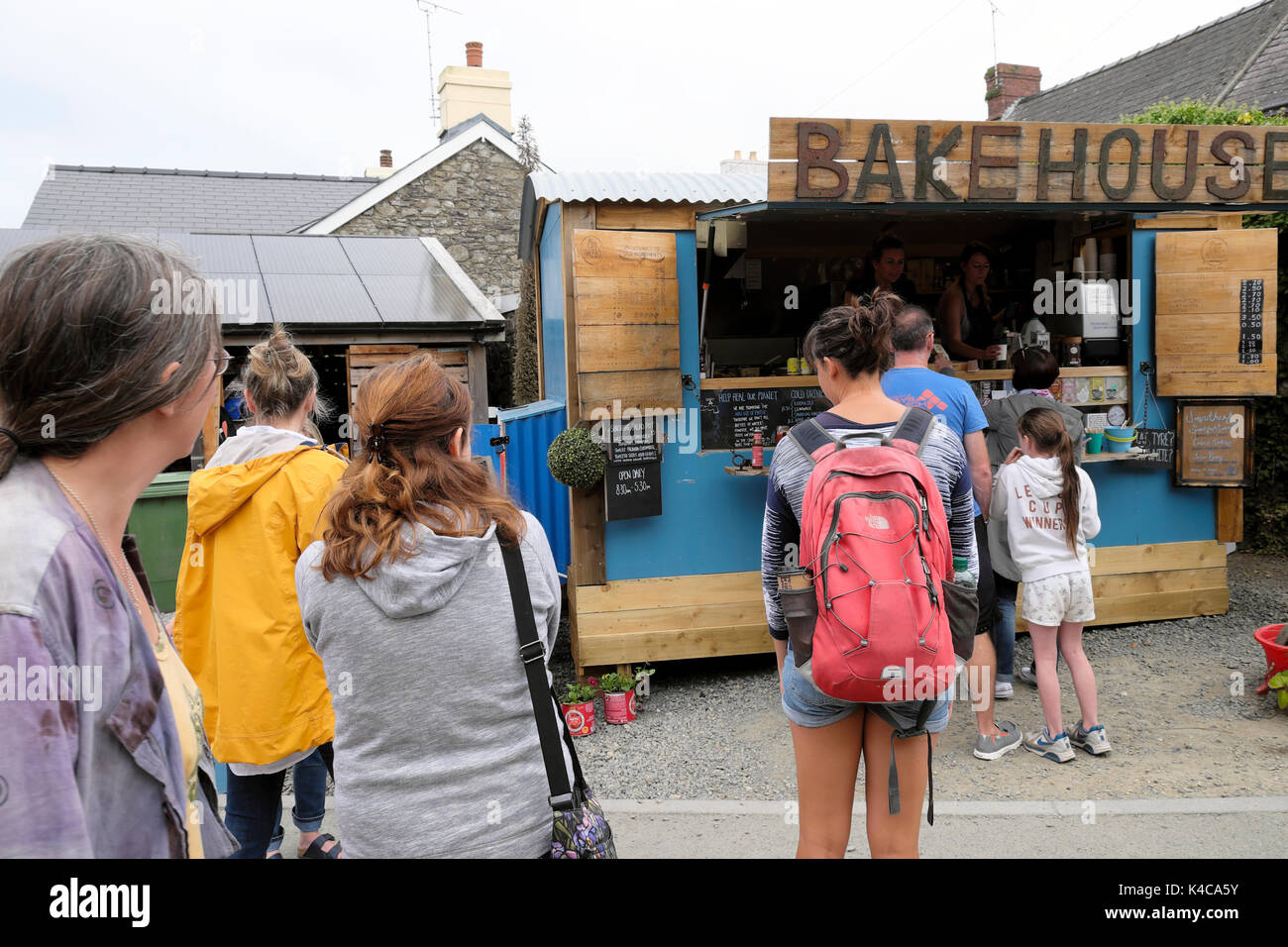 Customers standing outside the Bakehouse shack cafe restaurant in St Davids Pembrokeshire Wales UK  KATHY DEWITT - Stock Image