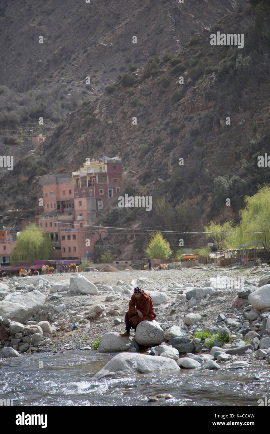 Berber man sitting by river, Setti Fatma, Ourika valley, Atlas Mountains, Morocco Stock Photo