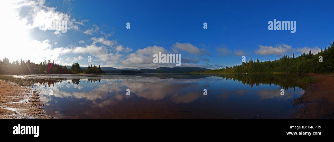Panorama view of the morning clouds are sitting on the Laurentides Hills at Lac Escalier in Mont-Tremblant National Park, Quebec, Canada, August 13, 2 - Stock Image