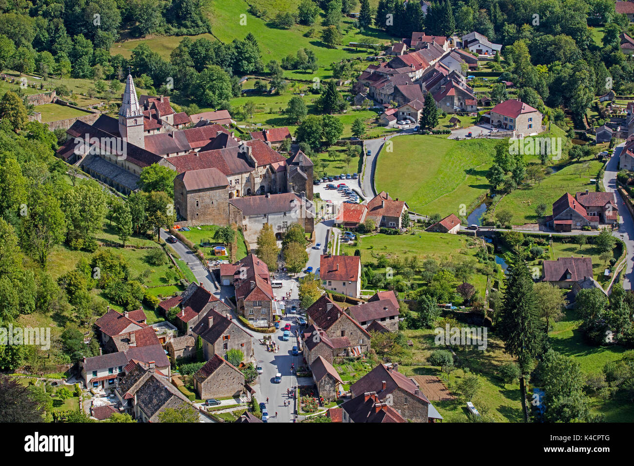Aerial view over the Baume Abbey / Abbaye Saint-Pierre de Baume-les-Messieurs and village, Jura department in Franche-Comté, Lons-le-Saunier, France - Stock Image