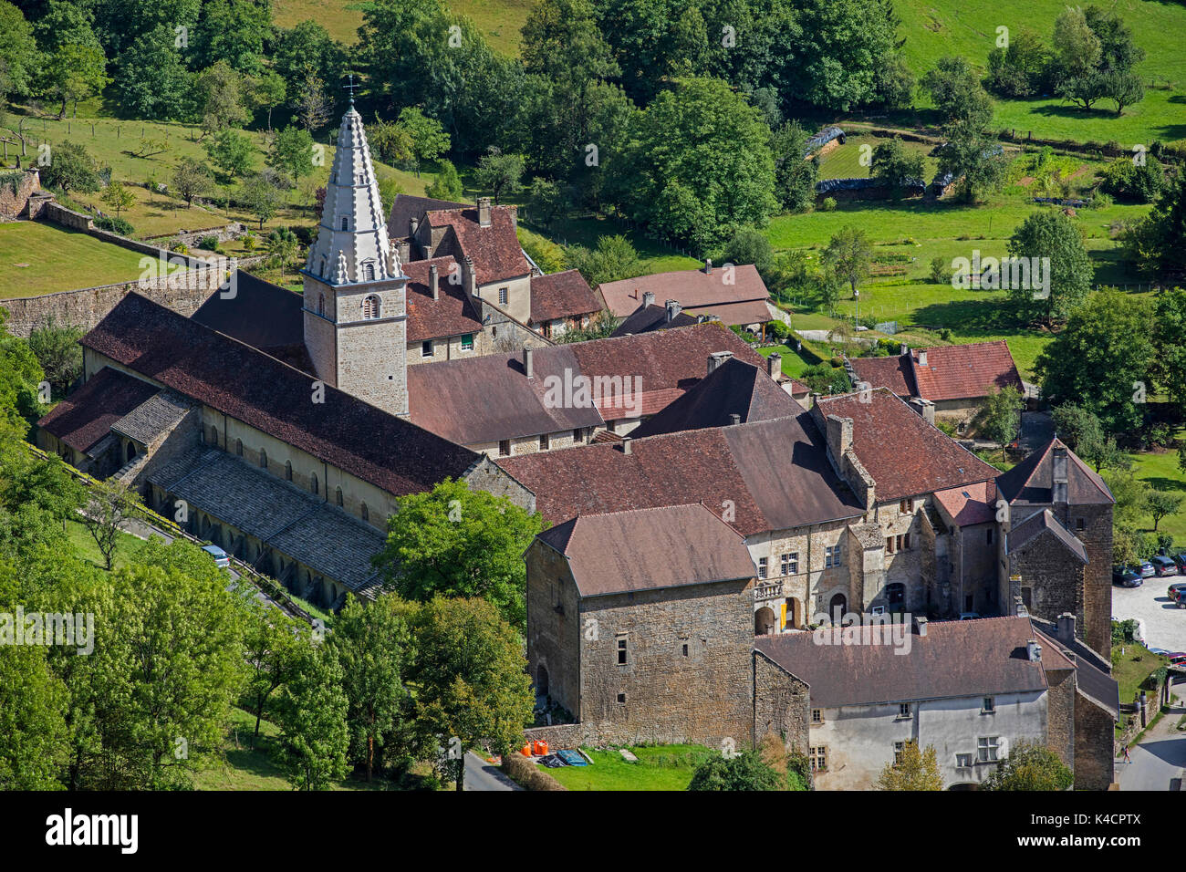 Aerial view over the Baume Abbey / Abbaye Saint-Pierre de Baume-les-Messieurs, Jura department in Franche-Comté, Lons-le-Saunier, France - Stock Image