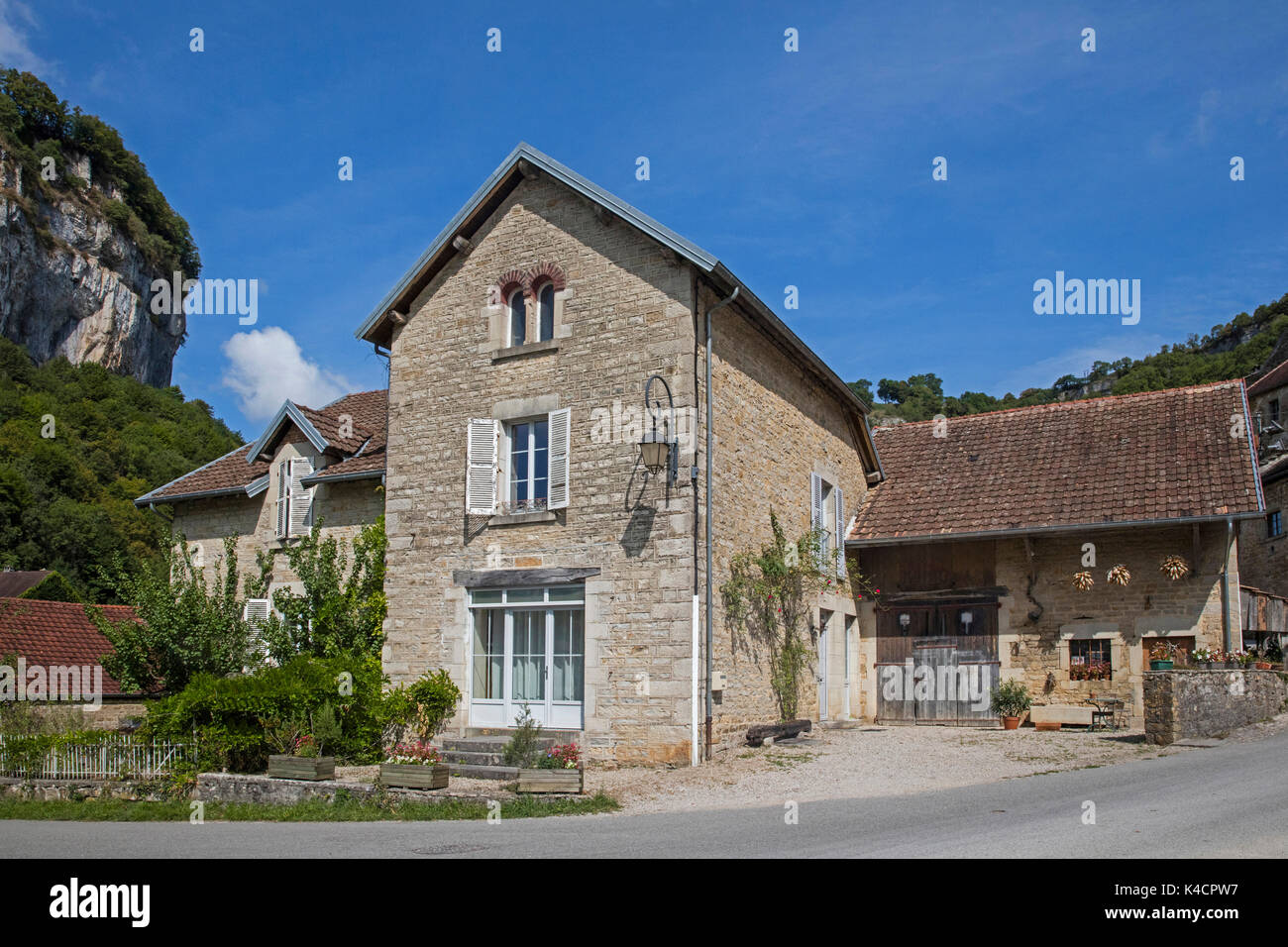 Typical house in the village Baume-les-Messieurs, Jura department in Franche-Comté, Lons-le-Saunier, France - Stock Image