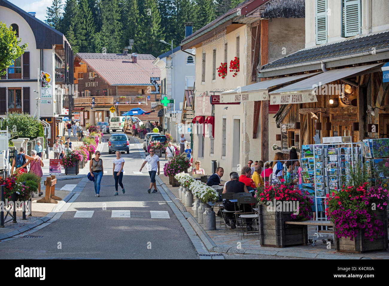 Shopping street in the village Les Rousses in the Canton of Morez of Jura department, Bourgogne-Franche-Comté, France - Stock Image