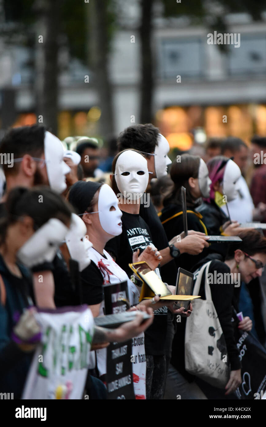 Earthlings Experience animal rights activists protesting outside Burger King in Leicester Square, London. Protesters wearing anonymous masks - Stock Image