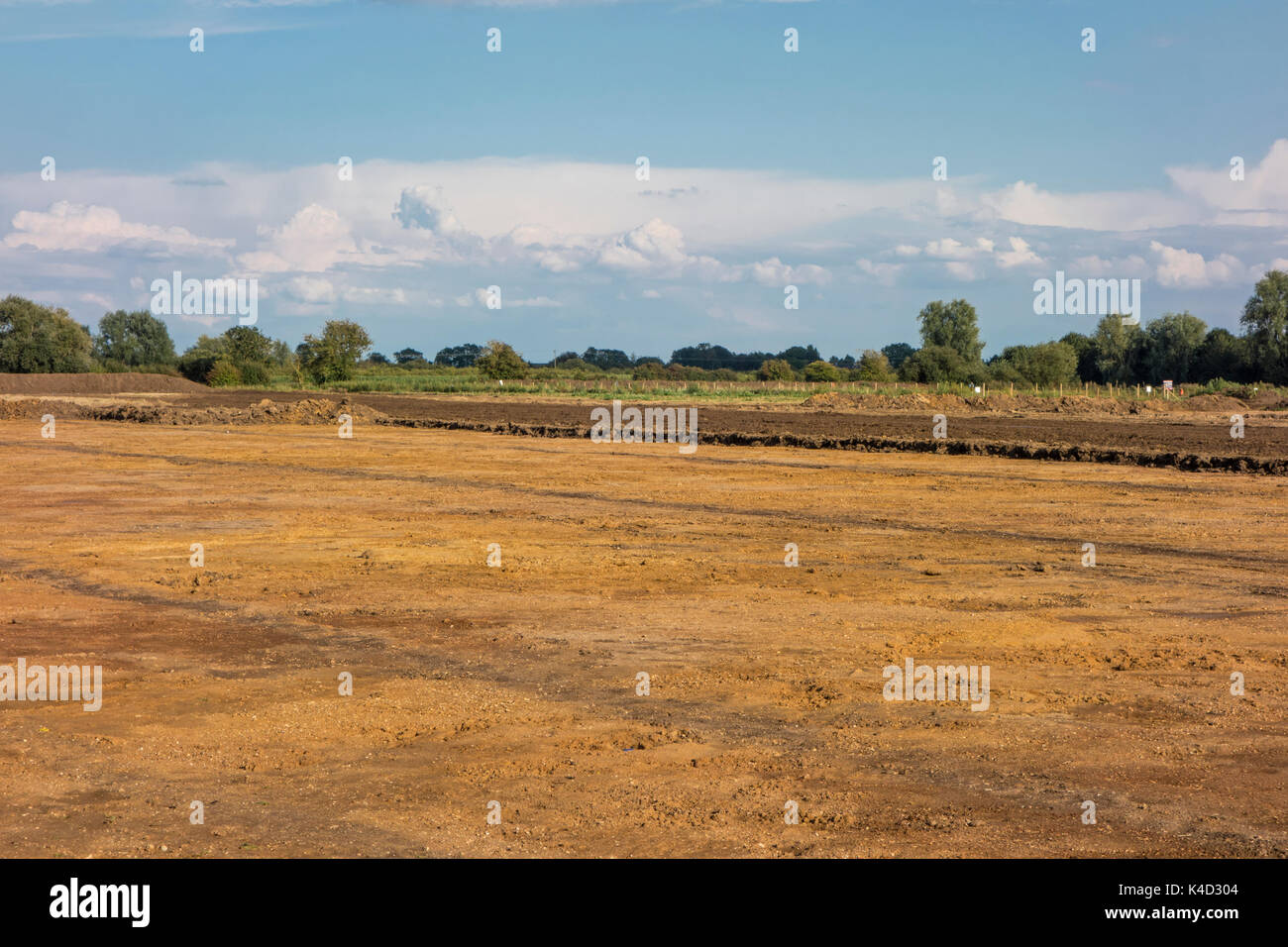 View of field from which top soil has been removed prior to gravel extraction, Cottenham, Cambridgeshire, England - Stock Image