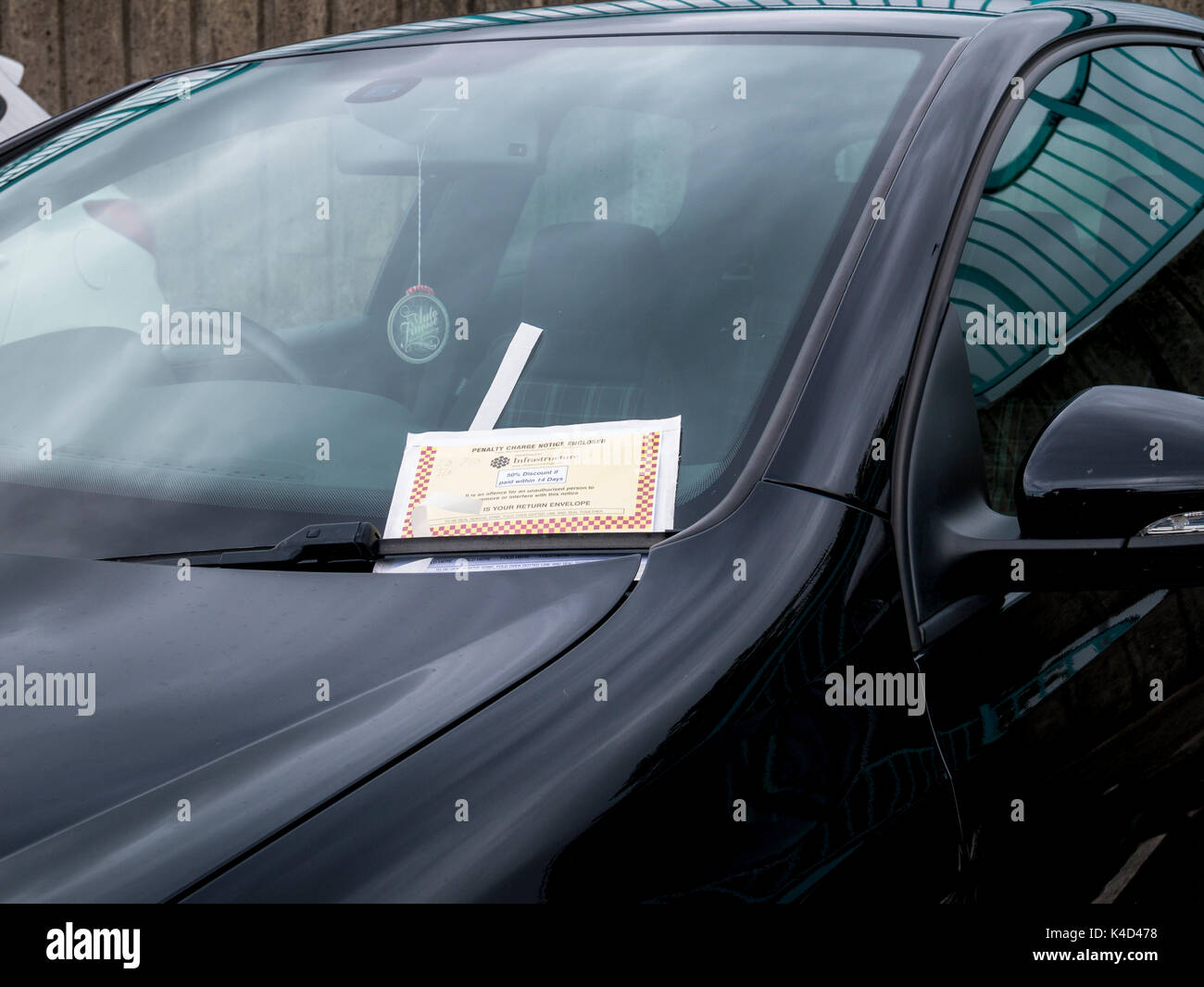 Penalty Charge Notice or Parking Ticket on the windscreen of a car - Stock Image