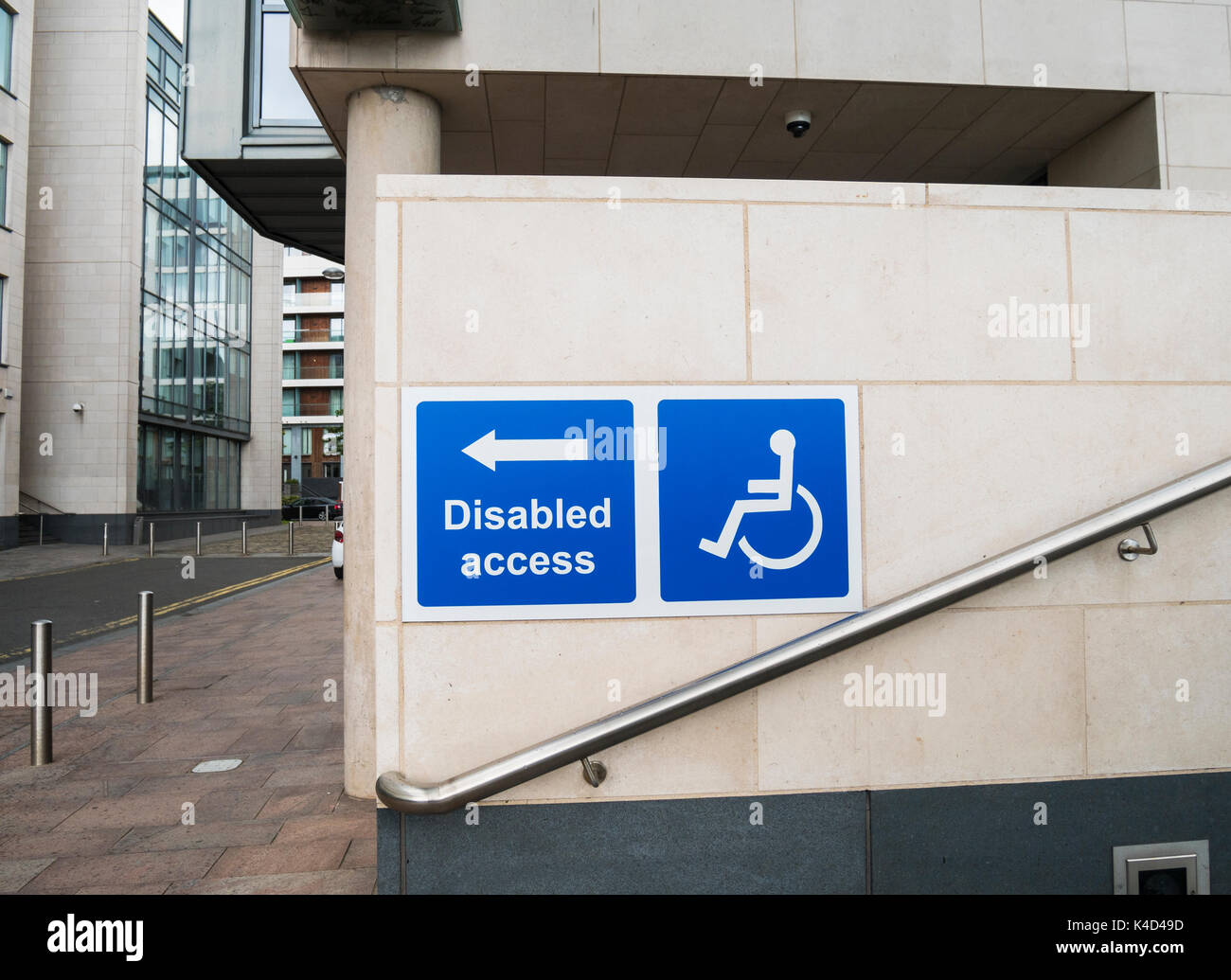 Disabled access sign on a modern Belfast building - Stock Image