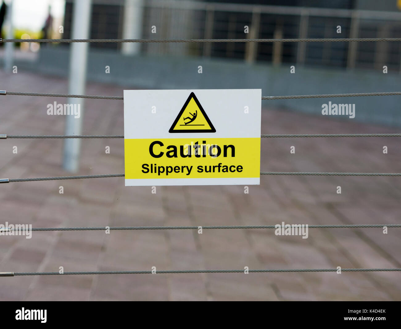 Sign warning Caution Slippery Surface - Stock Image