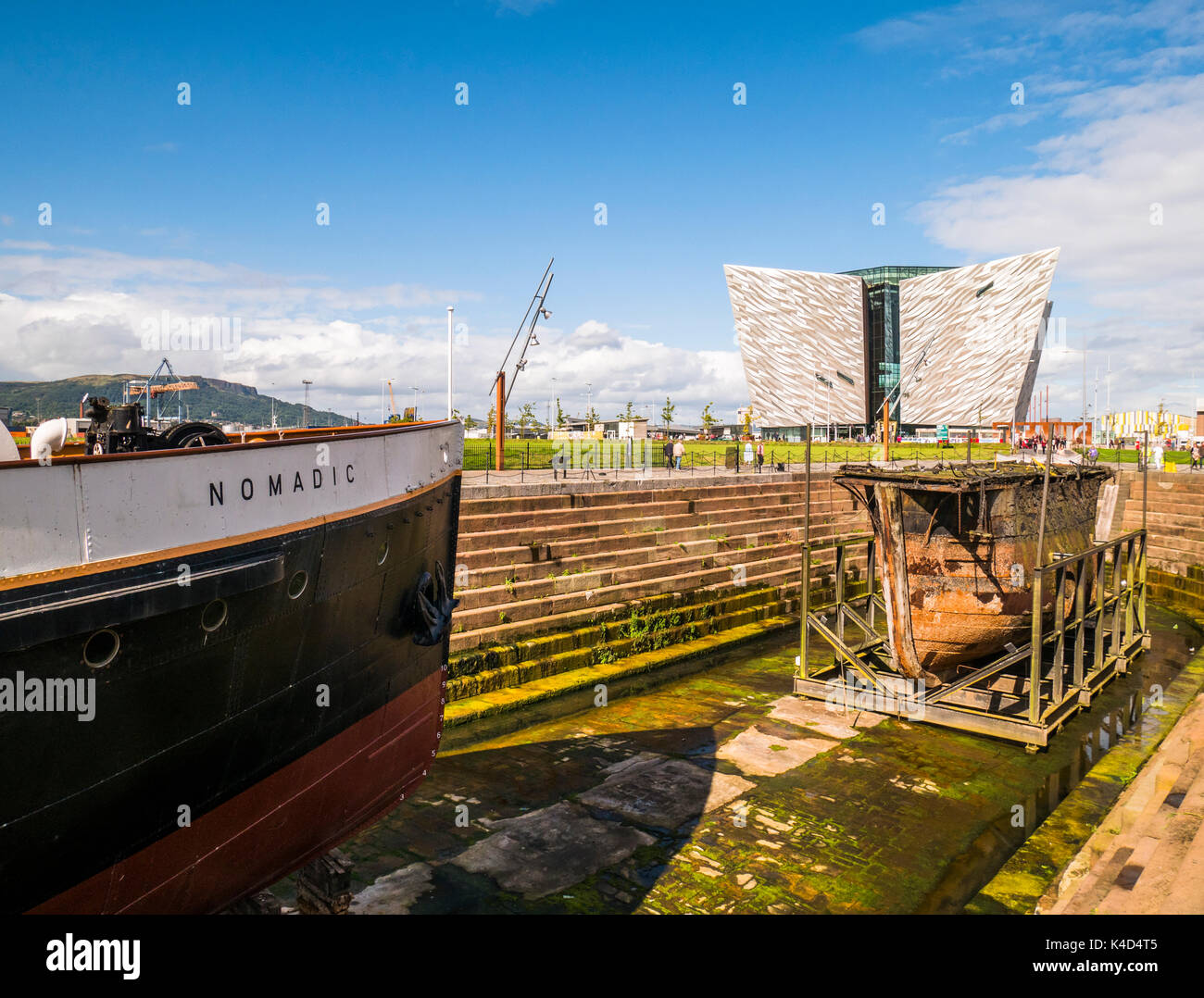 Bow of SS Nomadic with Titanic Belfast in background - Stock Image