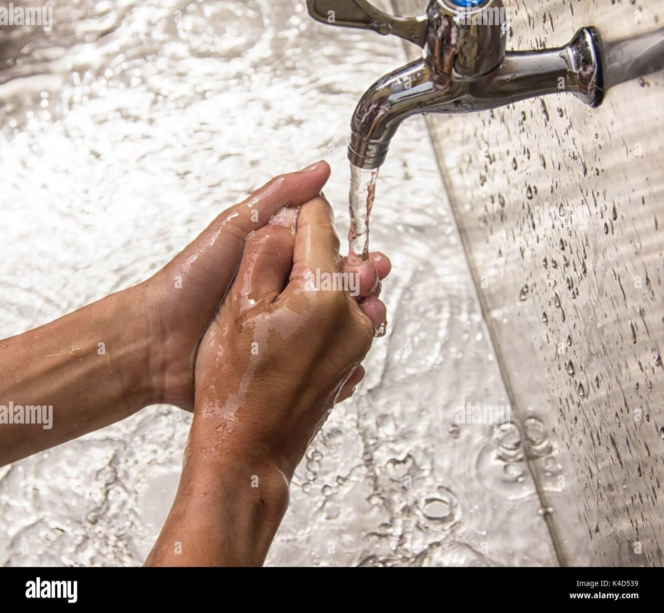 Closeup of an individual hand washing. - Stock Image