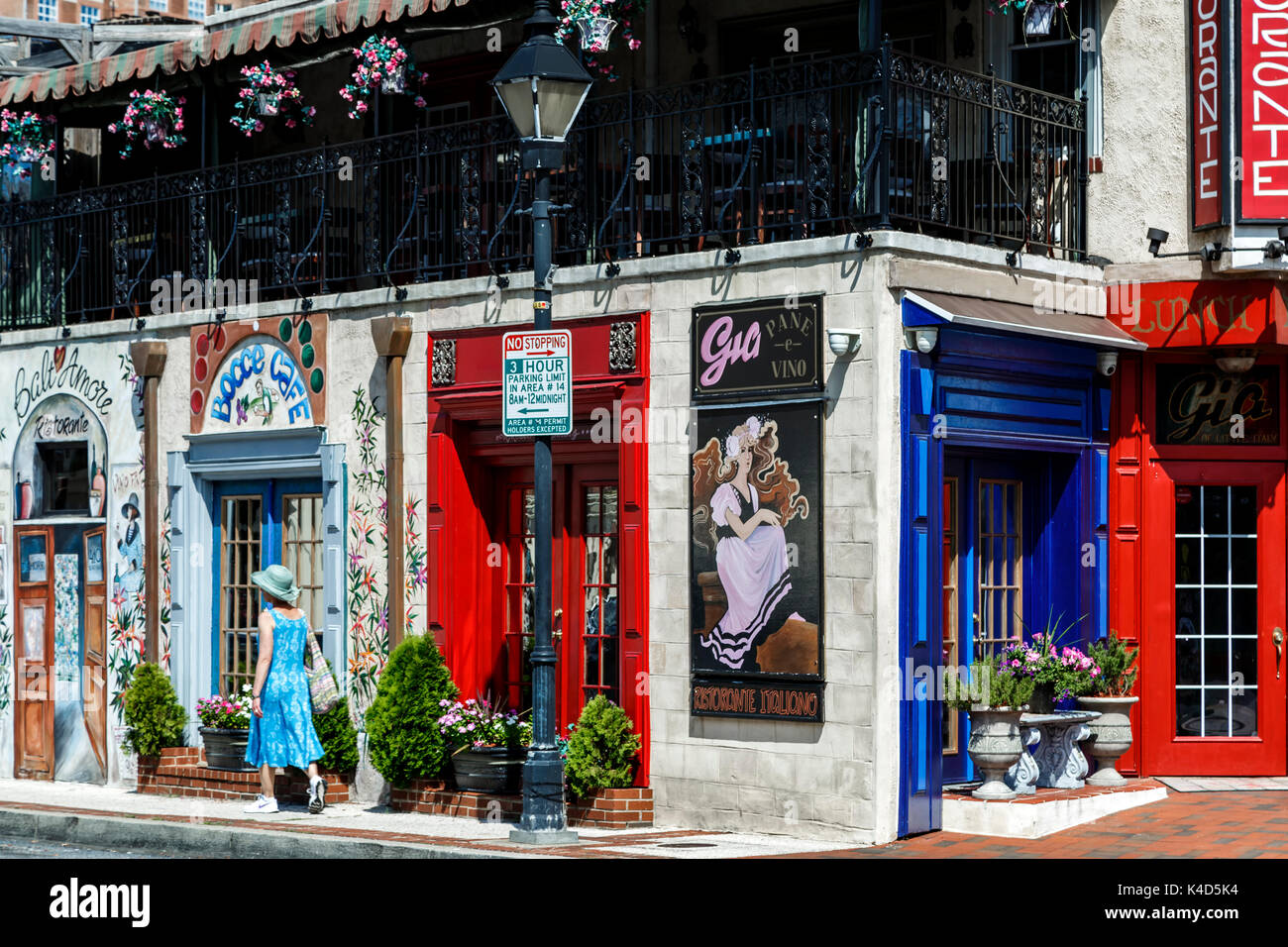 Woman walking in front of colorful Italian restaurant, Little Italy neighborhood, Baltimore, Maryland USA - Stock Image