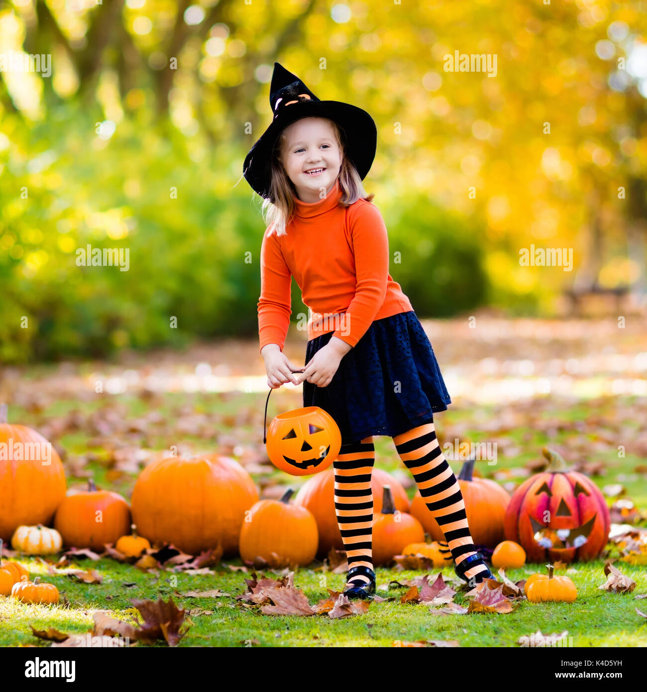 Kids with pumpkin on Halloween. Little girl in witch costume and hat playing in autumn park. Child at Halloween trick or treat. Kid trick or treating.  sc 1 st  Alamy & Kids with pumpkin on Halloween. Little girl in witch costume and hat ...