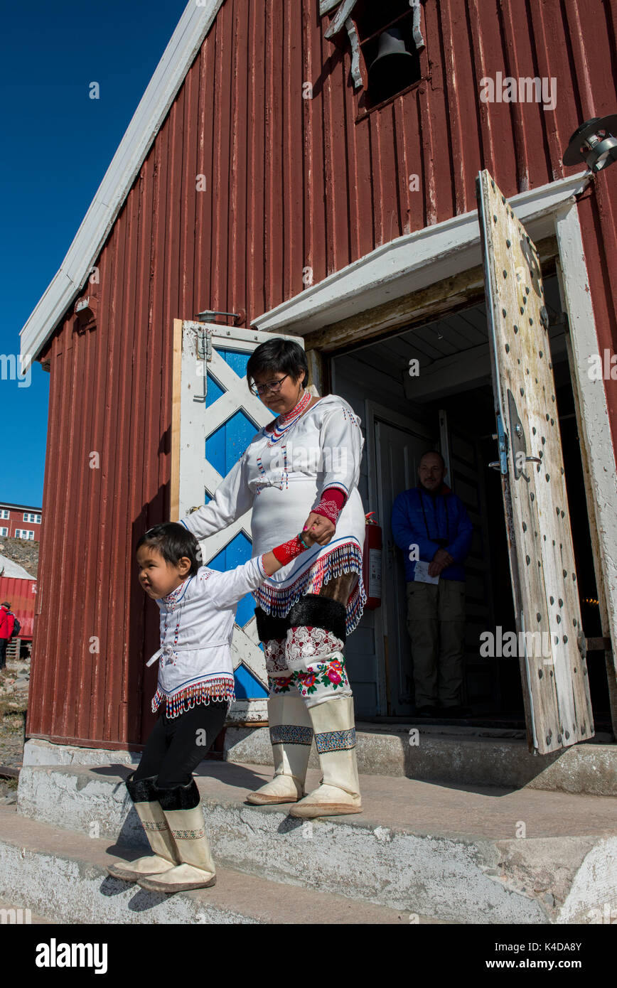 Greenland, Scoresbysund aka Scoresby Sund. Remote settlement of Ittoqqortoormiit, local woman and child in traditional Stock Photo
