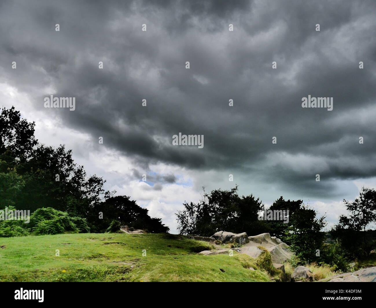 Moody skies above Black Rocks, Wirksworth, Derbyshire (Peak District National Park) - Stock Image