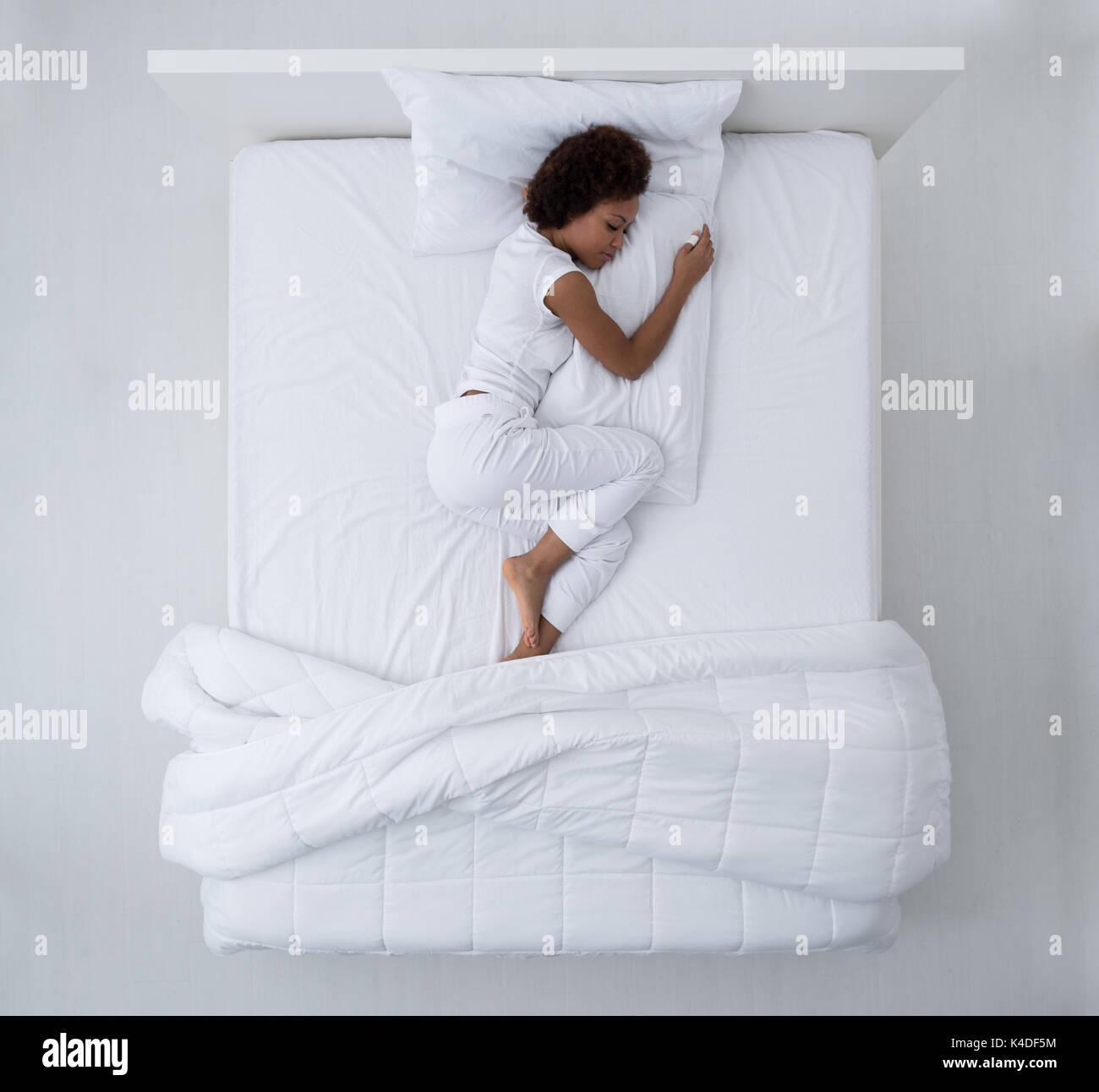 https://c8.alamy.com/comp/K4DF5M/beautiful-african-american-woman-lying-in-bed-and-sleeping-top-view-K4DF5M.jpg