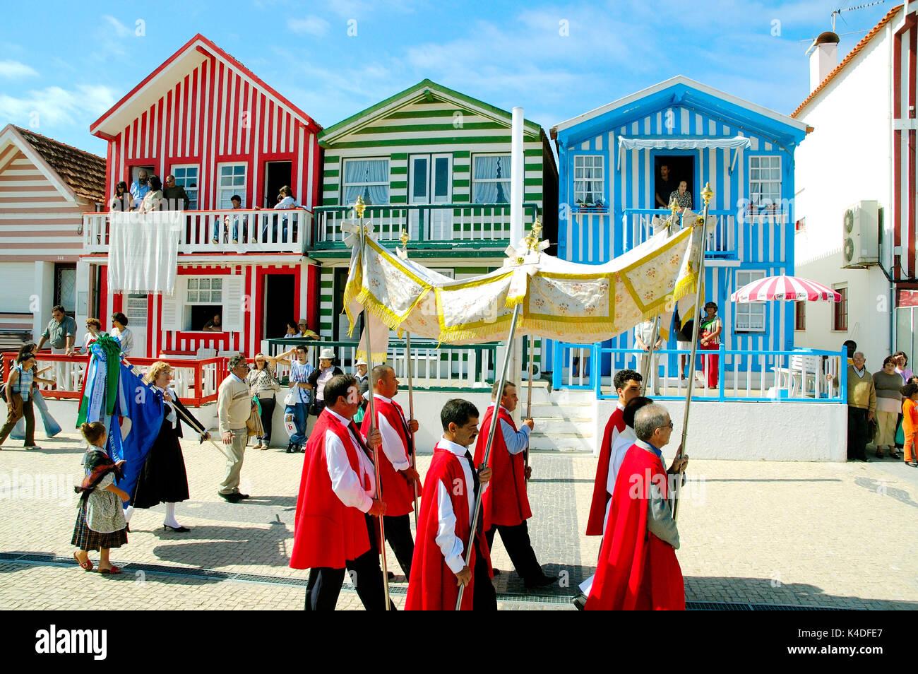 Religious procession during the traditional festivity of Nossa Senhora da Saúde. On the background the traditional Stock Photo