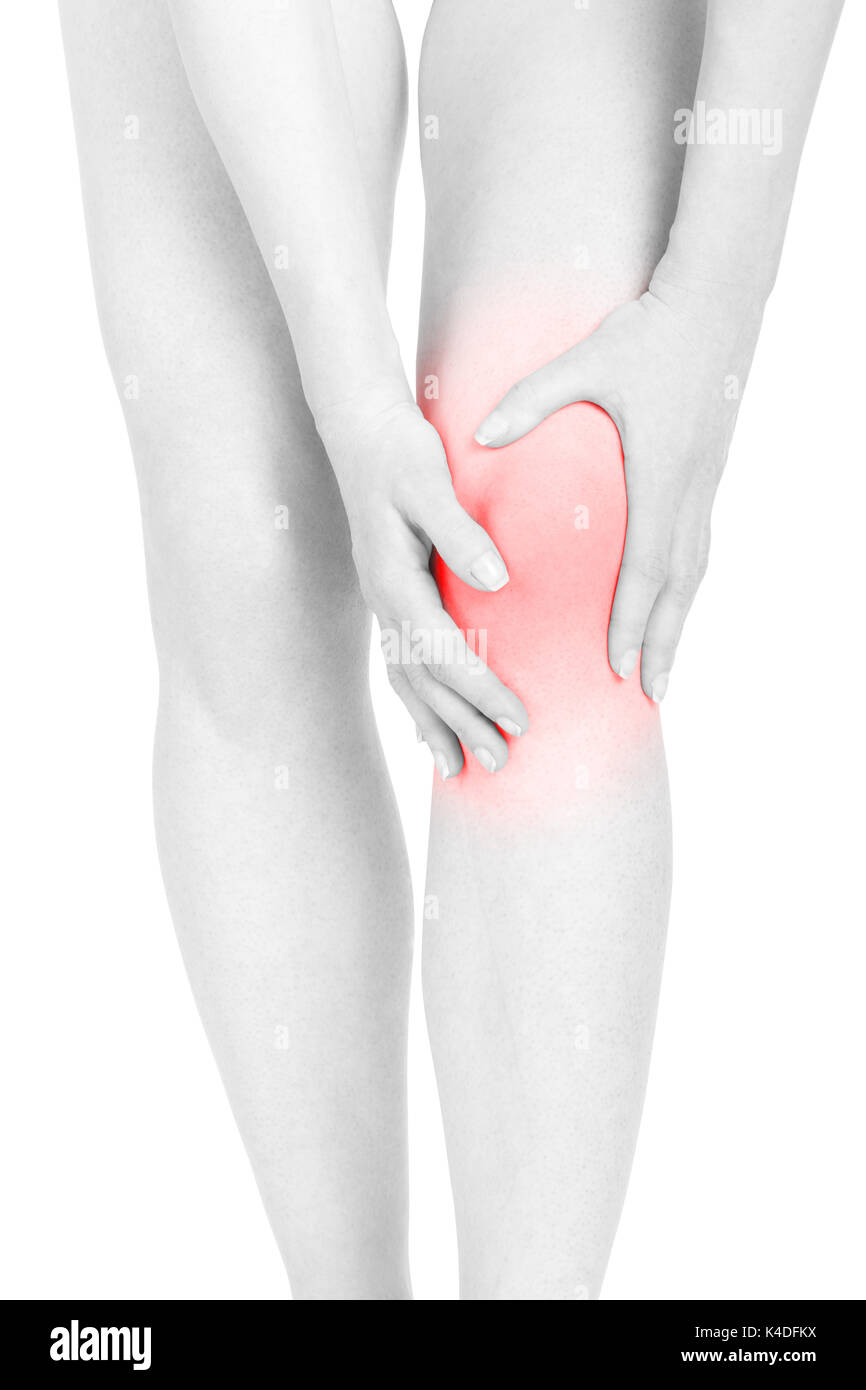 Woman fatigued legs with red pain area isolated on white, clipping path - Stock Image