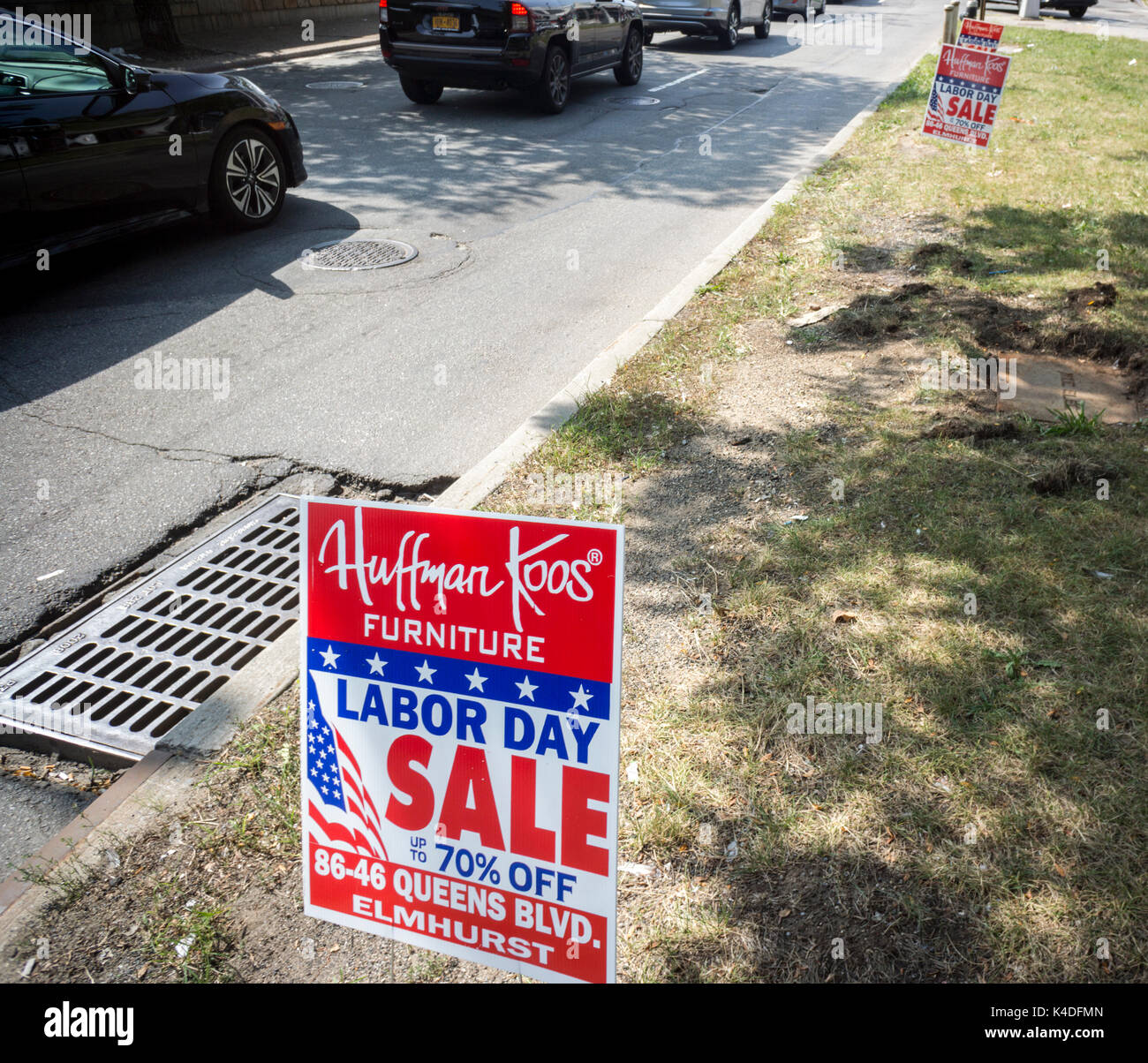 Signs placed along Queens boulevard in Queens In New York advertise the Labor Day sale of the Huffman Koos chain Stock Photo