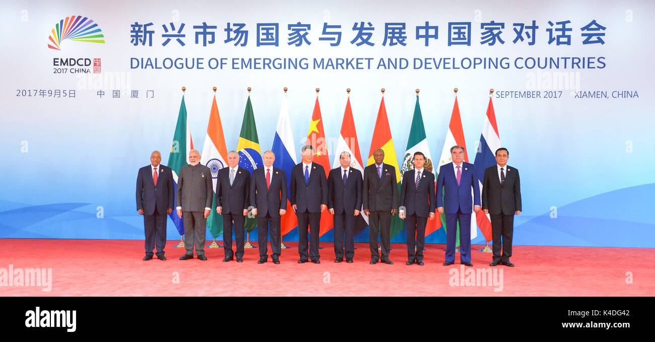 Leaders attending the BRICS Summit meeting on the Dialogue of Emerging Market and Developing Countries stand together Stock Photo