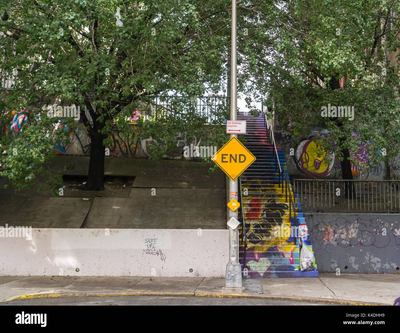 A decorated step street in the Bronx borough of New York on Sunday, September 3, 2017. Due to the hilly nature of Upper Manhattan and Western Bronx their are a number of streets that consisted of pedestrian steps but under the purview of the NYC Dept. of Transportation. This 'I Love the Bronx' street, an extension of Henwood Place, was painted by Clark Fly ID under the auspices of a program by ArtBridge. (© Richard B. Levine) - Stock Image