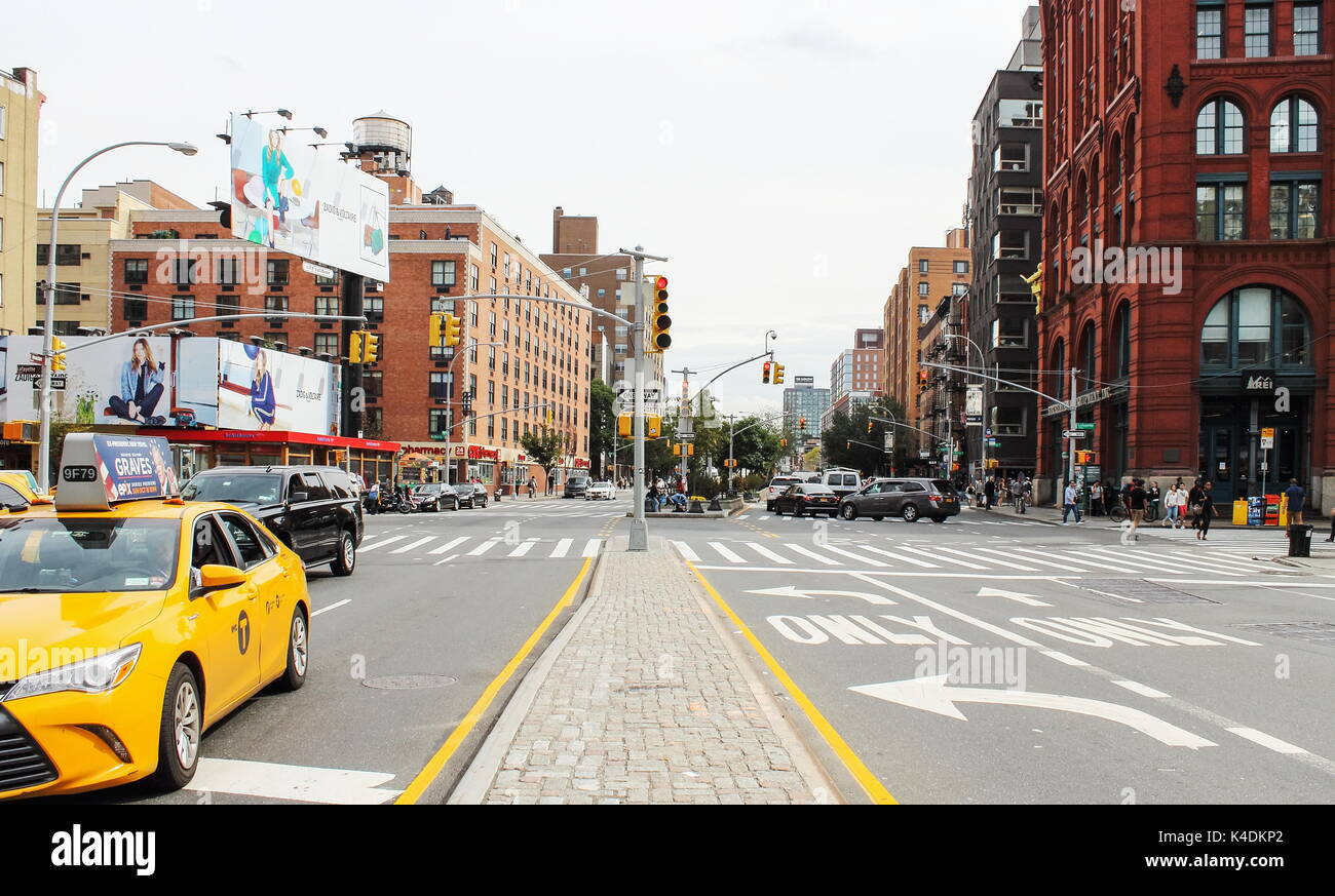 New York, USA - September 2016: Houston Street is a major east-west thoroughfare in downtown Manhattan, running crosstown across the full width of the - Stock Image