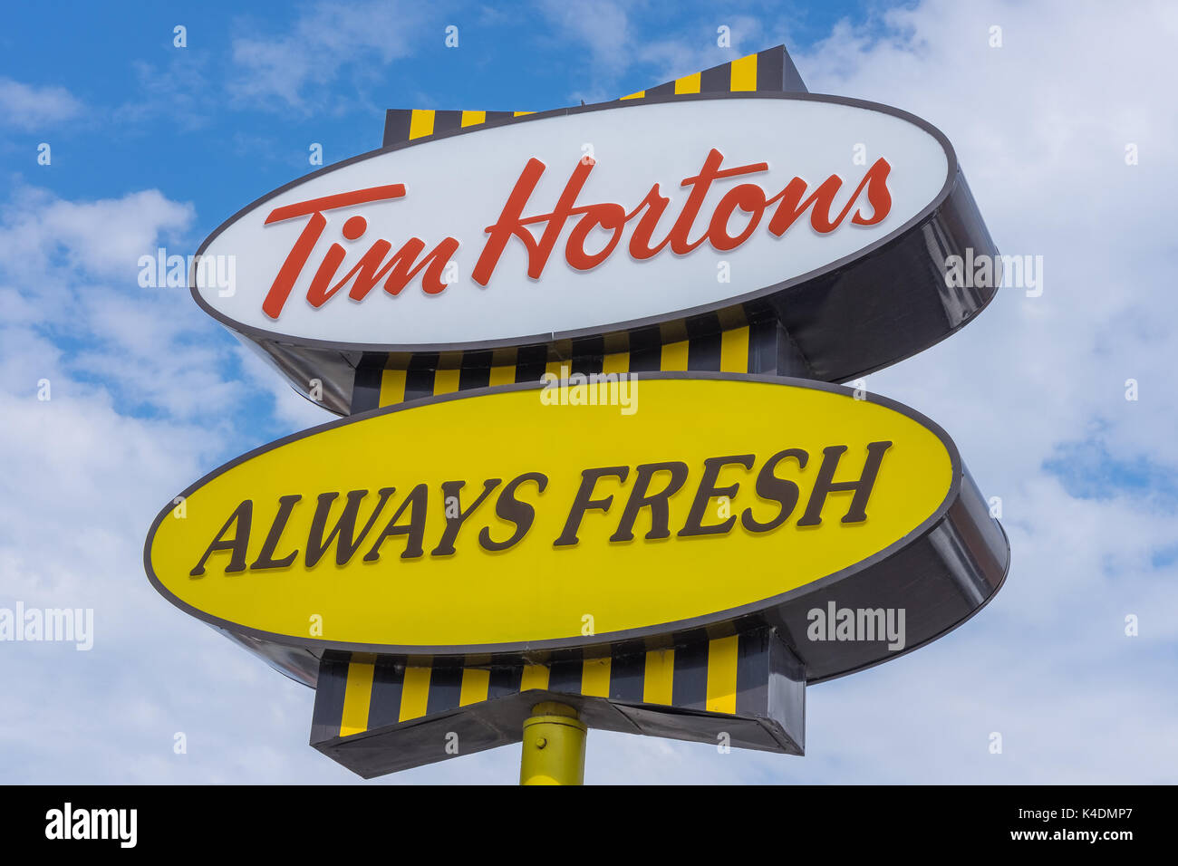 Tim Hortons is a Canadian multinational restaurant coffee shop chain best known for its coffee and doughnuts. - Stock Image