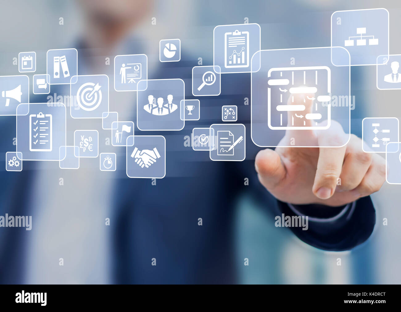 Manager touching AR virtual screen interface button about project management with icons of scheduling, budgeting, communication - Stock Image