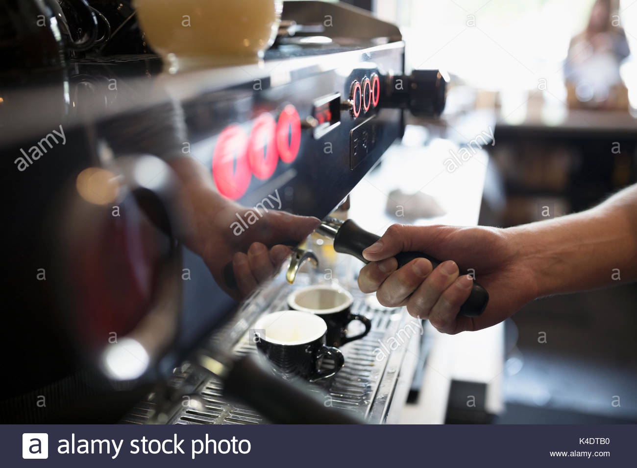 Close up barista using, making espresso machine in cafe - Stock Image