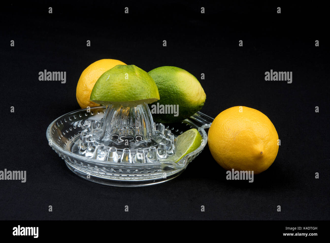 Juicer and citrus fruits. Stock Photo